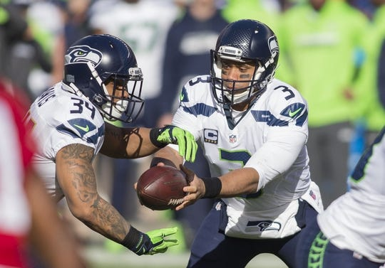 Jan 1, 2017; Santa Clara, CA, USA; Seattle Seahawks quarterback Russell Wilson (3) hands off the football to running back Thomas Rawls (34) during the first quarter against the San Francisco 49ers at Levis Stadium. Mandatory Credit: Neville E. Guard-USA TODAY Sports