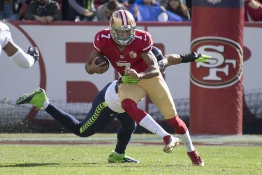 January 1, 2017; Santa Clara, CA, USA; San Francisco 49ers quarterback Colin Kaepernick (7) runs past Seattle Seahawks outside linebacker K.J. Wright (50) during the first quarter at Levi's Stadium. Mandatory Credit: Kyle Terada-USA TODAY Sports