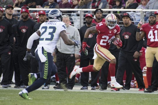 January 1, 2017; Santa Clara, CA, USA; San Francisco 49ers running back Shaun Draughn (24) runs with the football against Seattle Seahawks free safety Steven Terrell (23) during the first quarter at Levi's Stadium. Mandatory Credit: Kyle Terada-USA TODAY Sports