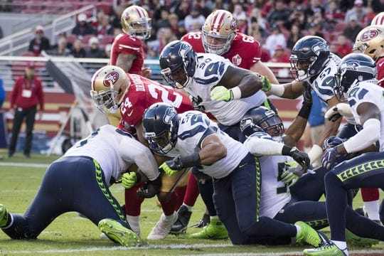 January 1, 2017; Santa Clara, CA, USA; San Francisco 49ers running back Shaun Draughn (24) scores a touchdown against the Seattle Seahawks during the first quarter at Levi's Stadium. Mandatory Credit: Kyle Terada-USA TODAY Sports