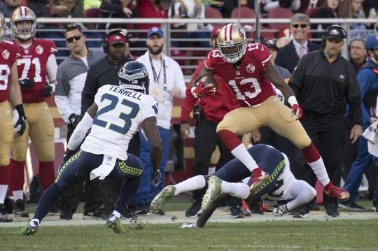 January 1, 2017; Santa Clara, CA, USA; San Francisco 49ers wide receiver Aaron Burbridge (13) jumps over Seattle Seahawks cornerback Jeremy Lane (20) during the second quarter at Levi's Stadium. Mandatory Credit: Kyle Terada-USA TODAY Sports