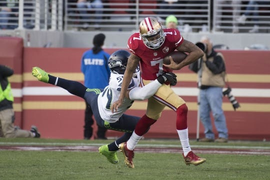 January 1, 2017; Santa Clara, CA, USA; San Francisco 49ers quarterback Colin Kaepernick (7) runs past Seattle Seahawks middle linebacker Bobby Wagner (54) during the second quarter at Levi's Stadium. Mandatory Credit: Kyle Terada-USA TODAY Sports