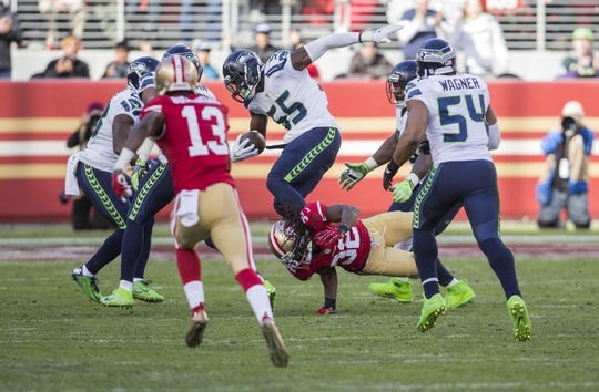 Jan 1, 2017; Santa Clara, CA, USA; Seattle Seahawks defensive end Frank Clark (55) is tackled by San Francisco 49ers running back DuJuan Harris (32) during the second quarter at Levis Stadium. Mandatory Credit: Neville E. Guard-USA TODAY Sports