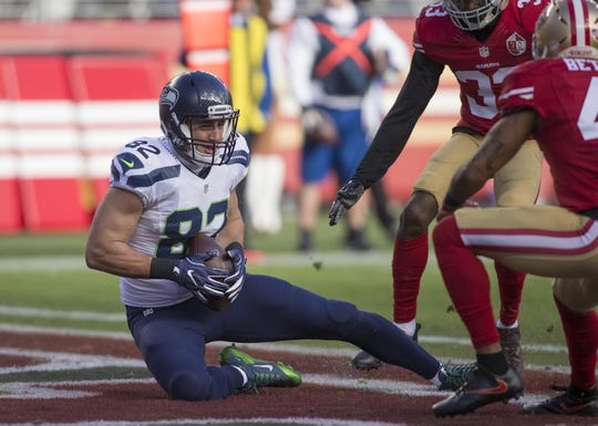 Jan 1, 2017; Santa Clara, CA, USA; Seattle Seahawks tight end Luke Willson (82) catches a touchdown pass San Francisco 49ers during the second qurater at Levis Stadium. Mandatory Credit: Neville E. Guard-USA TODAY Sports