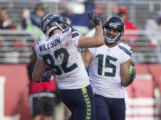 Jan 1, 2017; Santa Clara, CA, USA; Seattle Seahawks wide receiver Jermaine Kearse (15) and tight end Luke Willson (82) celebrate after a touchdown against the San Francisco 49ers during the second quarter at Levis Stadium. Mandatory Credit: Neville E. Guard-USA TODAY Sports