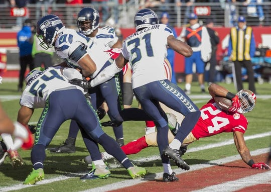 Jan 1, 2017; Santa Clara, CA, USA; San Francisco 49ers running back Shaun Draughn (24) scores a touchdown against the Seattle Seahawks during the second quarter at Levis Stadium. Mandatory Credit: Neville E. Guard-USA TODAY Sports