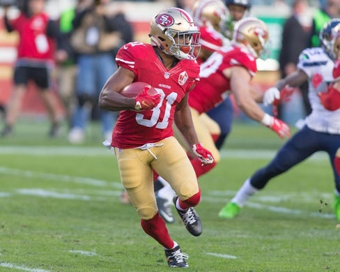 Jan 1, 2017; Santa Clara, CA, USA; San Francisco 49ers running back Raheem Mostert (31) rushes with the football against the Seattle Seahawks during the second quarter at Levis Stadium. Mandatory Credit: Neville E. Guard-USA TODAY Sports