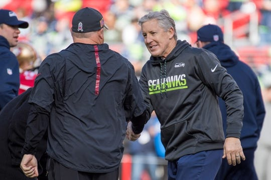 January 1, 2017; Santa Clara, CA, USA; Seattle Seahawks head coach Pete Carroll (right) shakes hands with San Francisco 49ers head coach Chip Kelly (left) before the game at Levi's Stadium. The Seahawks defeated the 49ers 25-23. Mandatory Credit: Kyle Terada-USA TODAY Sports