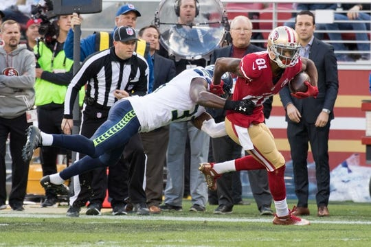 January 1, 2017; Santa Clara, CA, USA; San Francisco 49ers wide receiver Rod Streater (81) is tackled by Seattle Seahawks strong safety Kam Chancellor (31) during the first quarter at Levi's Stadium. The Seahawks defeated the 49ers 25-23. Mandatory Credit: Kyle Terada-USA TODAY Sports
