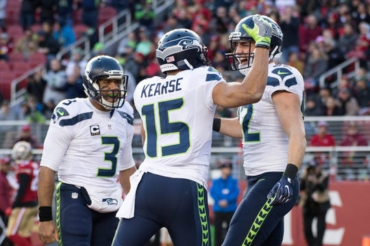 January 1, 2017; Santa Clara, CA, USA; Seattle Seahawks tight end Luke Willson (82) is congratulated by quarterback Russell Wilson (3) and wide receiver Jermaine Kearse (15) for scoring a touchdown during the second quarter against the San Francisco 49ers at Levi's Stadium. The Seahawks defeated the 49ers 25-23. Mandatory Credit: Kyle Terada-USA TODAY Sports
