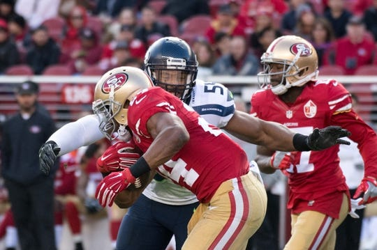 January 1, 2017; Santa Clara, CA, USA; Seattle Seahawks middle linebacker Bobby Wagner (54) tackles San Francisco 49ers running back Shaun Draughn (24) during the second quarter at Levi's Stadium. The Seahawks defeated the 49ers 25-23. Mandatory Credit: Kyle Terada-USA TODAY Sports