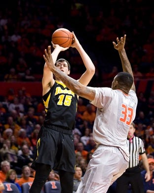 Jan 25, 2017; Champaign, IL, USA; Iowa Hawkeyes forward Ryan Kriener (15) shoots defended by Illinois Fighting Illini center Mike Thorne Jr. (33) during the second half at State Farm Center. Illinois beat Iowa 76 to 64.  Mandatory Credit: Mike Granse-USA TODAY Sports