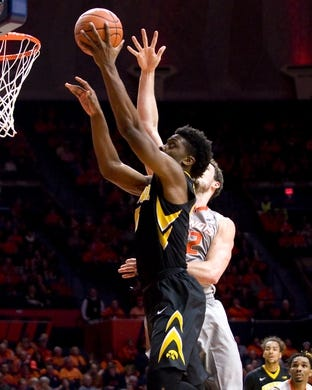 Jan 25, 2017; Champaign, IL, USA; Iowa Hawkeyes forward Tyler Cook (5) shoots defended by Illinois Fighting Illini center Maverick Morgan (22) during the second half at State Farm Center. Illinois beat Iowa 76 to 64.  Mandatory Credit: Mike Granse-USA TODAY Sports