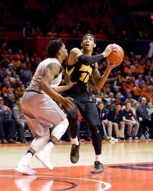 Jan 25, 2017; Champaign, IL, USA; Iowa Hawkeyes guard Christian Williams (10) drives to the basket defended by Illinois Fighting Illini guard Tracy Abrams (13) during the second half at State Farm Center. Illinois beat Iowa 76 to 64.  Mandatory Credit: Mike Granse-USA TODAY Sports