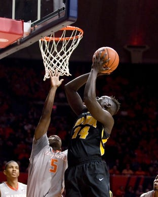 Jan 25, 2017; Champaign, IL, USA; Iowa Hawkeyes guard Peter Jok (14) shoots defended by Illinois Fighting Illini guard Jalen Coleman-Lands (5) during the second half at State Farm Center. Illinois beat Iowa 76 to 64.  Mandatory Credit: Mike Granse-USA TODAY Sports