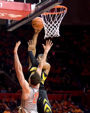 Jan 25, 2017; Champaign, IL, USA; Iowa Hawkeyes forward Ahmad Wagner (0) shoots defended by Illinois Fighting Illini center Maverick Morgan (22) during the second half at State Farm Center. Illinois beat Iowa 76 to 64.  Mandatory Credit: Mike Granse-USA TODAY Sports