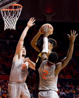 Jan 25, 2017; Champaign, IL, USA; Iowa Hawkeyes forward Ahmad Wagner (0) shoots defended by Illinois Fighting Illini center Maverick Morgan (22) and forward Kipper Nichols (2)during the second half at State Farm Center. Illinois beat Iowa 76 to 64.  Mandatory Credit: Mike Granse-USA TODAY Sports