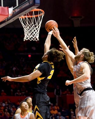 Jan 25, 2017; Champaign, IL, USA; Illinois Fighting Illini forward Michael Finke (43) and Iowa Hawkeyes forward Dom Uhl (25) compete for a rebound during the second half at State Farm Center. Illinois beat Iowa 76 to 64.  Mandatory Credit: Mike Granse-USA TODAY Sports