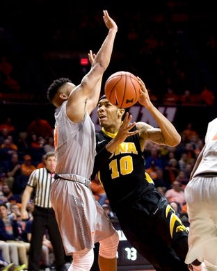 Jan 25, 2017; Champaign, IL, USA; Iowa Hawkeyes guard Christian Williams (10) drives to the basket defended by Illinois Fighting Illini guard Te'Jon Lucas (3) during the second half at State Farm Center. Illinois beat Iowa 76 to 64.  Mandatory Credit: Mike Granse-USA TODAY Sports