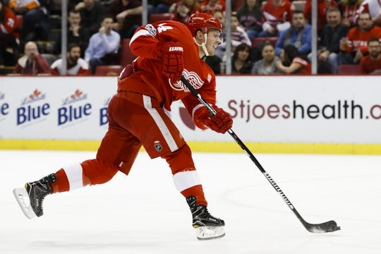 Feb 3, 2017; Detroit, MI, USA; Detroit Red Wings right wing Gustav Nyquist (14) takes a shot in the first period against the New York Islanders at Joe Louis Arena. Mandatory Credit: Rick Osentoski-USA TODAY Sports