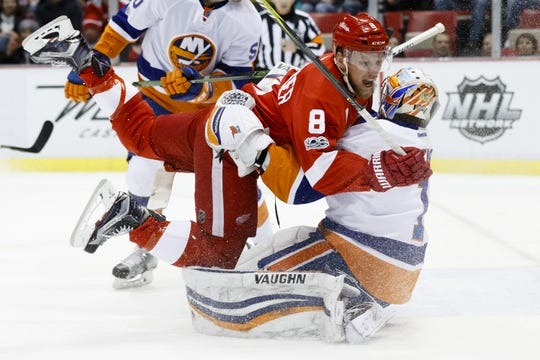 Feb 3, 2017; Detroit, MI, USA; Detroit Red Wings left wing Justin Abdelkader (8) collides with New York Islanders goalie Thomas Greiss (1) in the first period at Joe Louis Arena. Mandatory Credit: Rick Osentoski-USA TODAY Sports