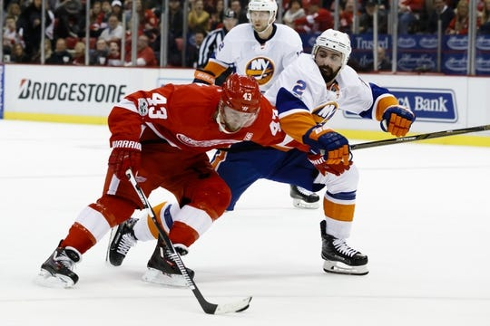 Feb 3, 2017; Detroit, MI, USA; Detroit Red Wings center Darren Helm (43) skates with the puck defended by New York Islanders defenseman Nick Leddy (2) in the first period at Joe Louis Arena. Mandatory Credit: Rick Osentoski-USA TODAY Sports