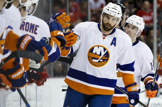Feb 3, 2017; Detroit, MI, USA; New York Islanders left wing Andrew Ladd (16) receives congratulations from teammates after scoring a goal in the first period against the Detroit Red Wings at Joe Louis Arena. Mandatory Credit: Rick Osentoski-USA TODAY Sports