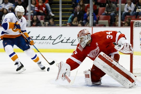 Feb 3, 2017; Detroit, MI, USA; Detroit Red Wings goalie Petr Mrazek (34) makes the save in front of New York Islanders left wing Andrew Ladd (16) in the second period at Joe Louis Arena. Mandatory Credit: Rick Osentoski-USA TODAY Sports