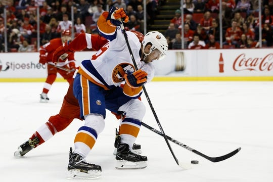 Feb 3, 2017; Detroit, MI, USA; New York Islanders left wing Josh Bailey (12) skates with the puck in the second period against the Detroit Red Wings at Joe Louis Arena. Mandatory Credit: Rick Osentoski-USA TODAY Sports
