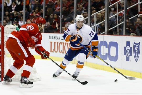 Feb 3, 2017; Detroit, MI, USA; New York Islanders left wing Anthony Beauvillier (72) skates with the puck defended by Detroit Red Wings defenseman Danny DeKeyser (65) in the second period at Joe Louis Arena. Mandatory Credit: Rick Osentoski-USA TODAY Sports