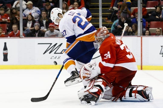 Feb 3, 2017; Detroit, MI, USA; New York Islanders left wing Anders Lee (27) tries to screen Detroit Red Wings goalie Petr Mrazek (34) in the second period at Joe Louis Arena. Mandatory Credit: Rick Osentoski-USA TODAY Sports