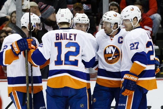 Feb 3, 2017; Detroit, MI, USA; New York Islanders center John Tavares (second from right) receives congratulations from teammates after scoring in the second period against the Detroit Red Wings at Joe Louis Arena. Mandatory Credit: Rick Osentoski-USA TODAY Sports