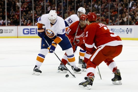 Feb 3, 2017; Detroit, MI, USA; New York Islanders left wing Nikolay Kulemin (86) skates with the puck defended by  Detroit Red Wings center Frans Nielsen (51) and defenseman Nick Jensen (3) in the second period at Joe Louis Arena. Mandatory Credit: Rick Osentoski-USA TODAY Sports