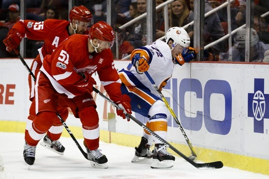 Feb 3, 2017; Detroit, MI, USA; New York Islanders left wing Anthony Beauvillier (72) and Detroit Red Wings center Frans Nielsen (51) battle for the puck in the second period at Joe Louis Arena. Mandatory Credit: Rick Osentoski-USA TODAY Sports
