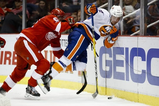 Feb 3, 2017; Detroit, MI, USA; Detroit Red Wings defenseman Niklas Kronwall (55) checks New York Islanders left wing Anthony Beauvillier (72) into the boards during the second period at Joe Louis Arena. Mandatory Credit: Rick Osentoski-USA TODAY Sports