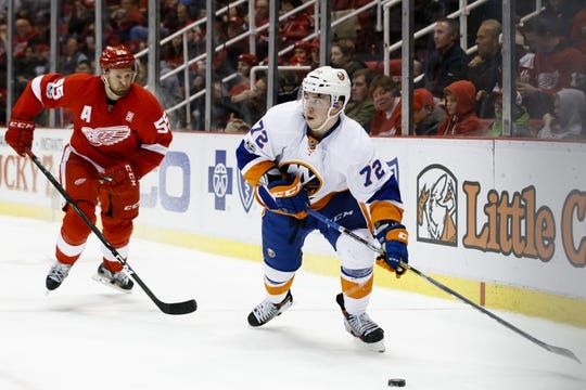 Feb 3, 2017; Detroit, MI, USA; New York Islanders left wing Anthony Beauvillier (72) skates with the puck chased by Detroit Red Wings defenseman Niklas Kronwall (55) in the second period at Joe Louis Arena. Mandatory Credit: Rick Osentoski-USA TODAY Sports