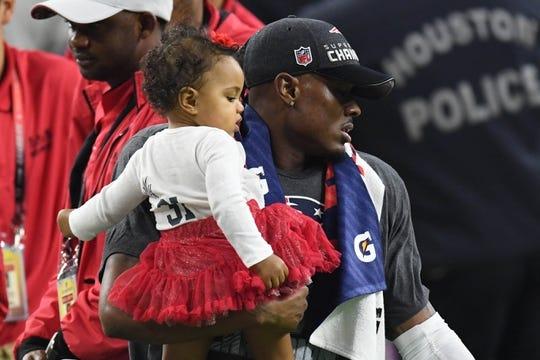 Feb 5, 2017; Houston, TX, USA; New England Patriots cornerback Jonathan Jones (31) is joined by his daughter Skylar Jones as he celebrates a win over the Atlanta Falcons during Super Bowl LI at NRG Stadium. The Patriots won 34-28. Mandatory Credit: Bob Donnan-USA TODAY Sports