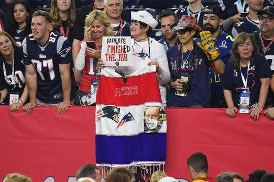 Feb 5, 2017; Houston, TX, USA; New England Patriots fan holds up a sign after the game against the Atlanta Falcons during Super Bowl LI at NRG Stadium. The Patriots won 34-28. Mandatory Credit: Bob Donnan-USA TODAY Sports