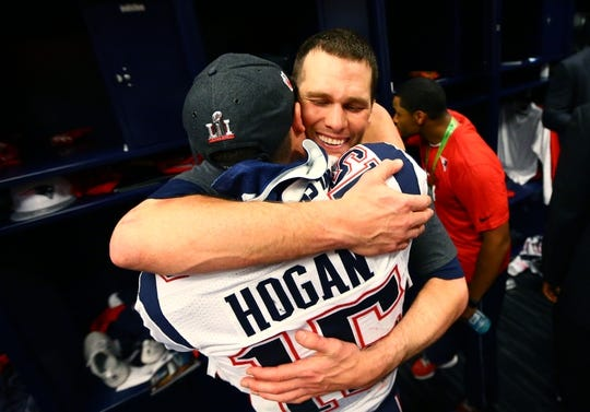Feb 5, 2017; Houston, TX, USA; New England Patriots quarterback Tom Brady hugs wide receiver Chris Hogan as they celebrate in the locker room after defeating the Atlanta Falcons during Super Bowl LI at NRG Stadium. Mandatory Credit: Mark J. Rebilas-USA TODAY Sports