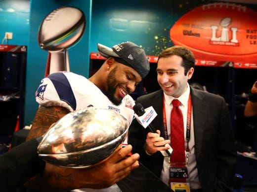 Feb 5, 2017; Houston, TX, USA; New England Patriots linebacker Elandon Roberts (52) celebrates with the Vince Lombardi trophy in the locker room after defeating the Atlanta Falcons during Super Bowl LI at NRG Stadium. Mandatory Credit: Mark J. Rebilas-USA TODAY Sports
