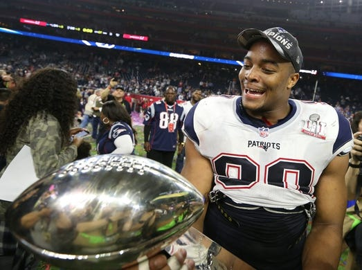 Feb 5, 2017; Houston, TX, USA; New England defensive end Trey Flowers (98) celebrates with the Vince Lombardi Trophy after beating the Atlanta Falcons during Super Bowl LI at NRG Stadium. Mandatory Credit: Matthew Emmons-USA TODAY Sports