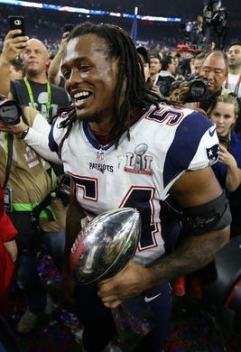 Feb 5, 2017; Houston, TX, USA; New England Patriots middle linebacker Dont'a Hightower (54) celebrates with the Vince Lombardi Trophy during Super Bowl LI at NRG Stadium. Mandatory Credit: Matthew Emmons-USA TODAY Sports