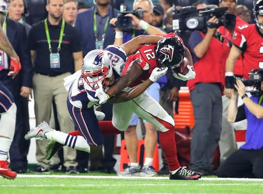 Feb 5, 2017; Houston, TX, USA; Atlanta Falcons wide receiver Mohamed Sanu (12) is tackled by New England Patriots cornerback Logan Ryan (26) in the fourth quarter during Super Bowl LI at NRG Stadium.Mandatory Credit: Mark J. Rebilas-USA TODAY Sports