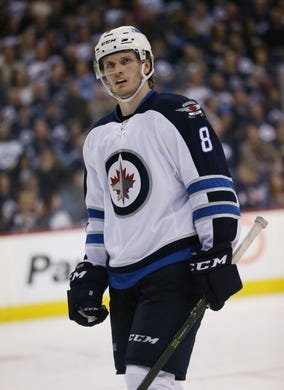 Mar 30, 2017; Winnipeg, Manitoba, CAN; Winnipeg Jets defenseman Jacob Trouba (8) gets set for a face off during the third period against the Anaheim Ducks at MTS Centre. The Jets won 4-3 in overtime. Mandatory Credit: Bruce Fedyck-USA TODAY Sports