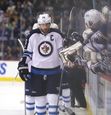 Mar 30, 2017; Winnipeg, Manitoba, CAN; Winnipeg Jets right wing Blake Wheeler (26) celebrates his goal with teammates during the third period against the Anaheim Ducks at MTS Centre. The Jets won 4-3 in overtime. Mandatory Credit: Bruce Fedyck-USA TODAY Sports