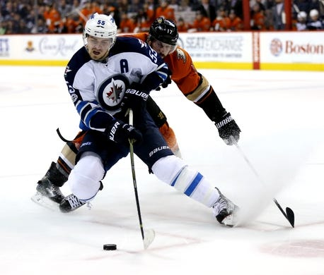 Mar 30, 2017; Winnipeg, Manitoba, CAN; Winnipeg Jets center Mark Scheifele (55) stops quickly on Anaheim Ducks center Ryan Kesler (17) during the overtime period at MTS Centre. The Jets won 4-3 in overtime. Mandatory Credit: Bruce Fedyck-USA TODAY Sports