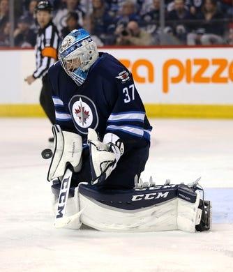 Apr 1, 2017; Winnipeg, Manitoba, CAN;  Winnipeg Jets goalie Connor Hellebuyck (37) makes a save during the third period against the Ottawa Senators at MTS Centre. Winnipeg won 4-2. Mandatory Credit: Bruce Fedyck-USA TODAY Sports