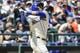 Jul 30, 2017; Seattle, WA, USA; Seattle Mariners right fielder Leonys Martin (12) hits a solo home run against the New York Mets during the second inning at Safeco Field. Mandatory Credit: Steven Bisig-USA TODAY Sports