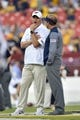 Sep 3, 2017; Landover, MD, USA; Virginia Tech Hokies head coach Justin Fuente, left, talks to West Virginia Mountaineers head coach Dana Holgorsen prior to a game at FedEx Field. Mandatory Credit: Derik Hamilton-USA TODAY Sports