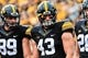 Sep 2, 2017; Iowa City, IA, USA; Iowa Hawkeyes linebacker Josey Jewell (43) and wide receiver Matt VandeBerg (89) watch the opening coin toss before the game between the Iowa Hawkeyes and the Wyoming Cowboys at Kinnick Stadium. Mandatory Credit: Jeffrey Becker-USA TODAY Sports